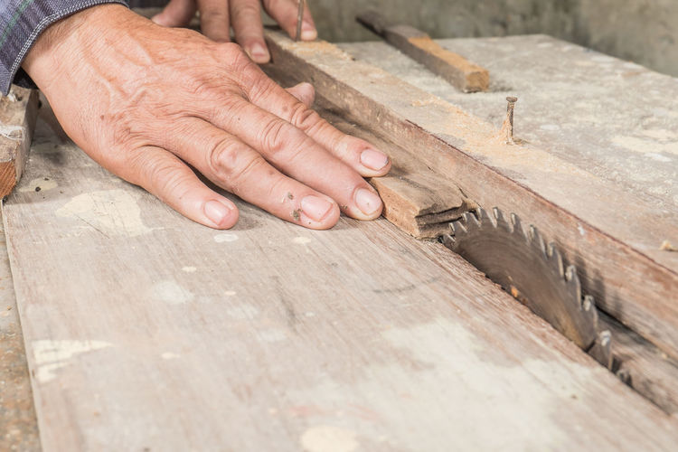 Cropped hands of carpenter working