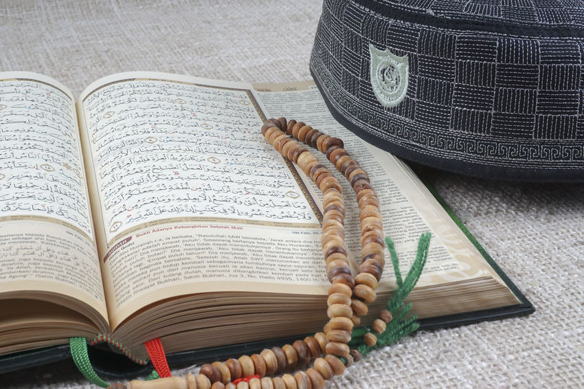 Quran and rosary Quran Rosary Book Close-up Day Educational Isolated On White Muslim No People
