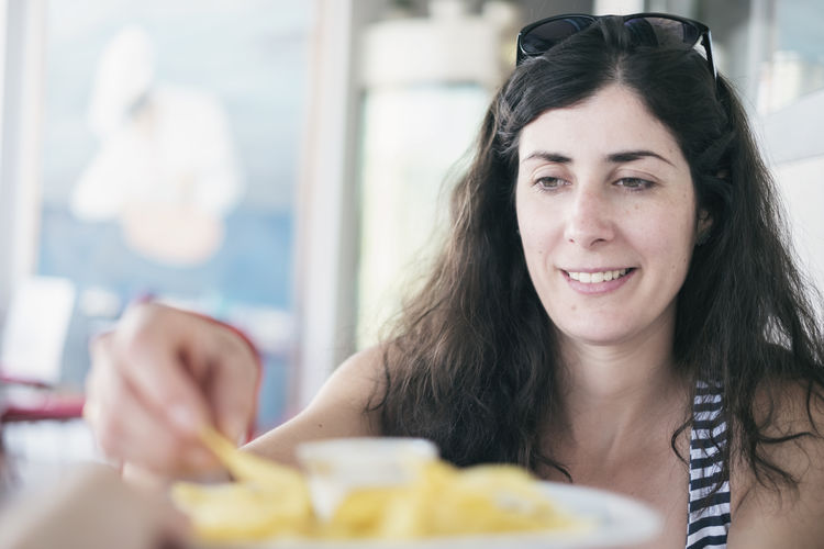 Smiling woman having food