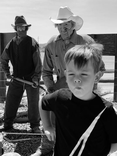 Portrait of a boy standing against built structure