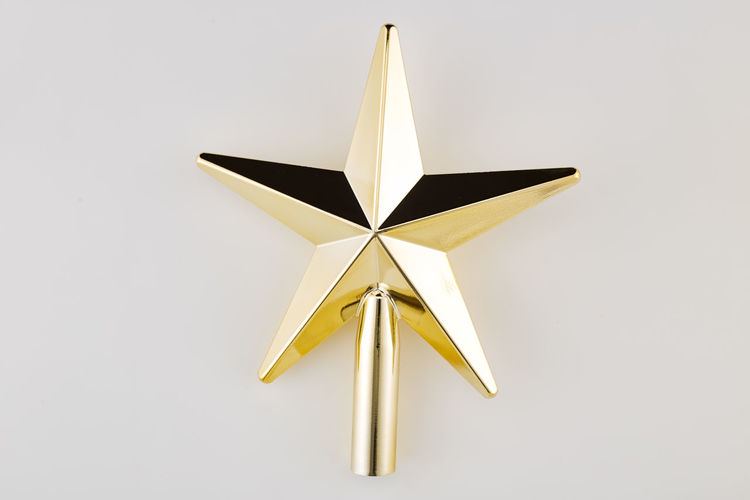 No People Studio Shot Indoors  White Background Single Object Star Shape Shape Still Life Metal Close-up Design Copy Space Gold Colored Christmas Decoration Cut Out White Color Shiny Low Angle View Creativity