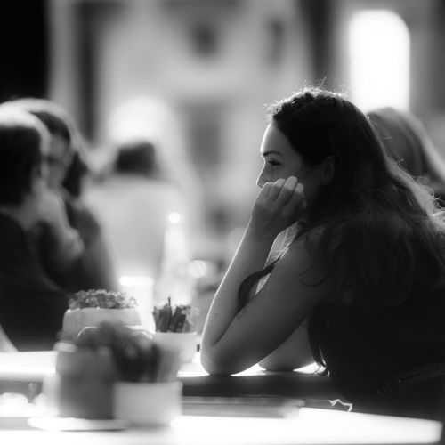 """""""Little Smile"""" Black Black & White Black And White Blackandwhite Close-up Coffee Day Focus On Foreground Food And Drink One Person Real People Table Women Young Women Women Around The World The Street Photographer - 2017 EyeEm Awards The Portraitist - 2017 EyeEm Awards Discover Berlin My Best Photo"""