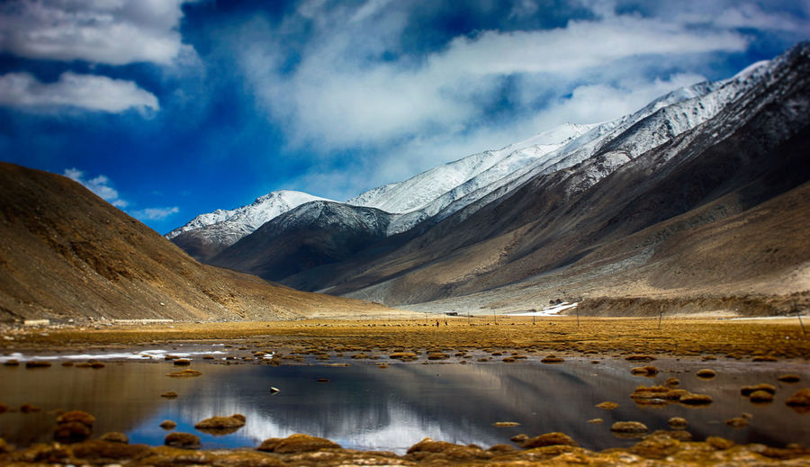 Beauty In Nature Cloud - Sky Cold Temperature Environment Ice Lake Landscape Mountain Mountain Range Nature No People Scenics - Nature Sky Snow Water Winter
