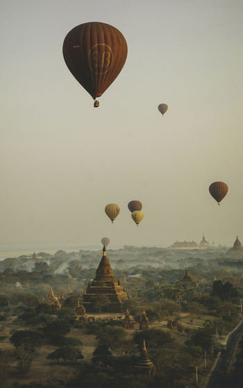 Hot air balloons over the Old Bagan, Myanmar in the early morning Religion Built Structure Architecture History No People Myanmar Myanmar Culture Buddha Buddhism Pagoda Temple Day Lily Light And Shadow Color Colors Colorful Bagan Bagan, Myanmar Stupa Spirituality Religious  Light Air Vehicle Hot Air Balloon Balloon Mid-air Sky Transportation Travel Flying Environment Nature Landscape Mode Of Transportation Adventure Place Of Worship Travel Destinations Outdoors Day Sunrise Morning Daylight