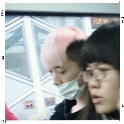 pinky hair boy on bus