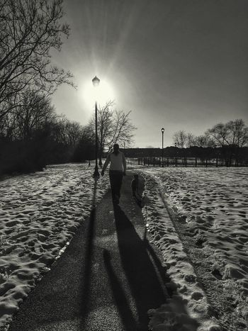 A change of pace Soaking Up The Sun Light And Shadow The Human Condition Snow Shadow Sunlight Black And White Open Edit For Everyone Blackandwhite Black & White