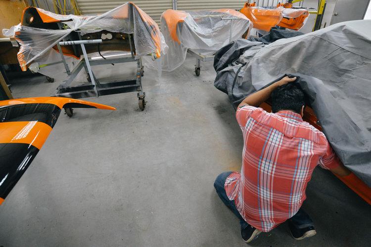 Mechanics repairing car at garage