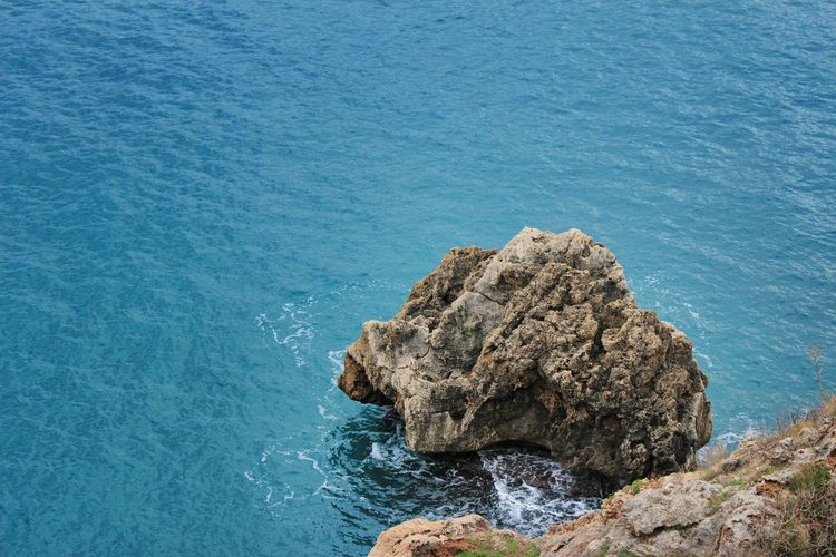 Jumping to conclusion Sea Rock Water Rock - Object Solid Beauty In Nature Rock Formation Blue Tranquility Scenics - Nature No People Nature Day Tranquil Scene High Angle View Land Outdoors Motion Wave Rocky Coastline Stack Rock Turquoise Colored Eroded Canon 600D DSLR The Great Outdoors - 2019 EyeEm Awards