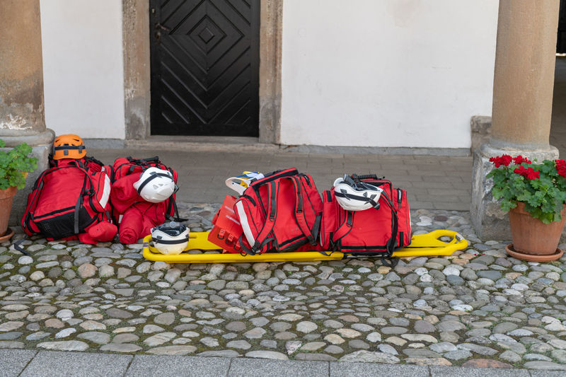 View of backpacks on street against house