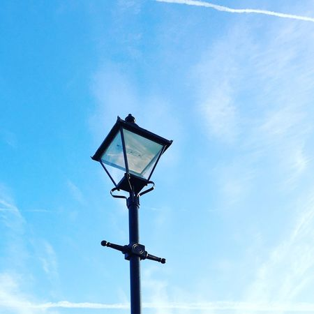 Street Light Low Angle View Lighting Equipment Blue Sky Pole High Section Outdoors Cloud Day Electric Light Lamp Post Cloud - Sky Scenics Lamppost No People Tranquility Avian