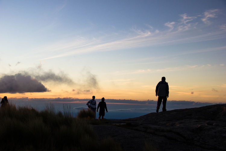 Silhouette Hikers On Mountain Against Sky During Sunset
