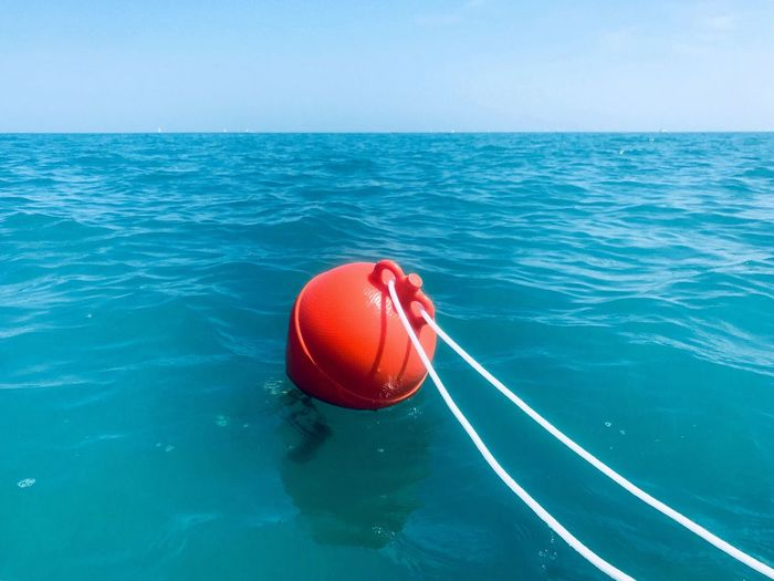 Sea EyeEm Selects Water Horizon Over Water Red Horizon Buoy No People Rope Floating On Water A New Perspective On Life