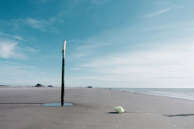 Low tide... SPO Horizon Open Wide EyeEm Selects Sky Beach Land Sea Day Nature Water Scenics - Nature Beauty In Nature Cloud - Sky Outdoors Blue Safety Tranquility No People Protection Tranquil Scene Pole The Great Outdoors - 2019 EyeEm Awards The Minimalist - 2019 EyeEm Awards