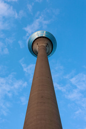 Rhine tower in Dusseldorf, Germany. Germany Düsseldorf Düsseldorf, Medienhafen City Rhine Tower Architecture Built Structure Building Exterior Tall - High Low Angle View Tower Sky No People Blue Travel Travel Destinations Day Cloud - Sky Nature Tourism Outdoors Global Communications Spire