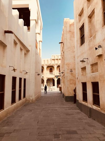 Arabian Moment Built Structure Architecture Building Exterior Building The Way Forward Direction Real People Rear View Incidental People Residential District Women Sky Men Lifestyles Adult Day Walking Street Nature City