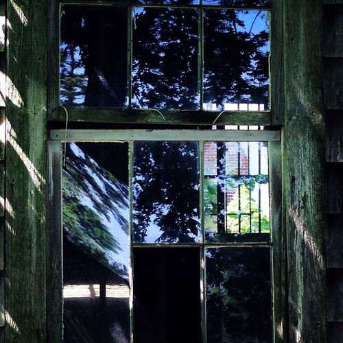The Illuminator - 2014 EyeEm Awards an ok barn with reflections of times gone by