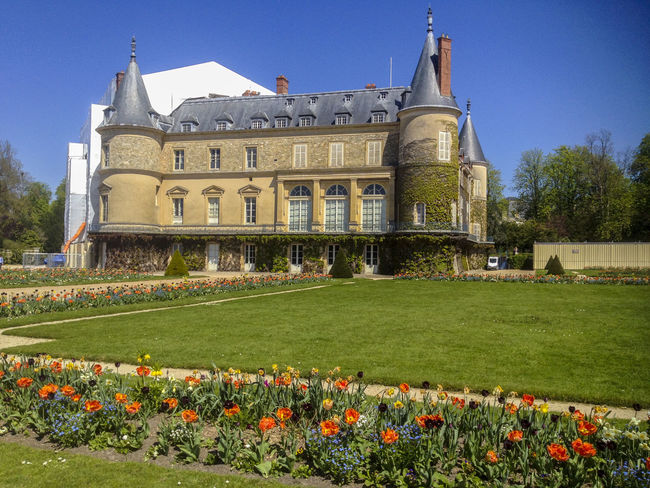 Rambouillet, France, Scenic View of French Castle Architectural Column Architecture Blue Built Structure Capital Cities  Day Façade Flower France French Castle Grass Grassy Green Color Growth Lawn Nature Outdoors Plant Sky Tourism Travel Destinations