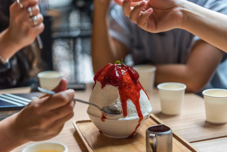 People eating ice cream on table