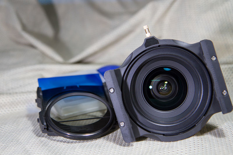 Close-up of camera on bed