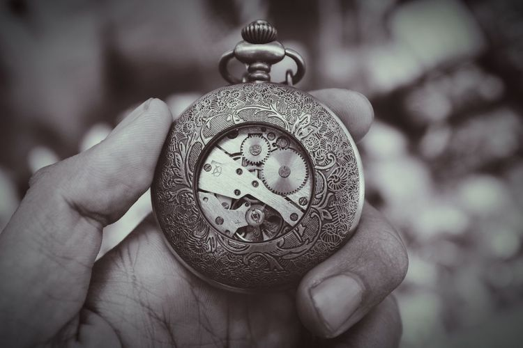Cropped Image Of Hand Holding Antique Pocket Watch