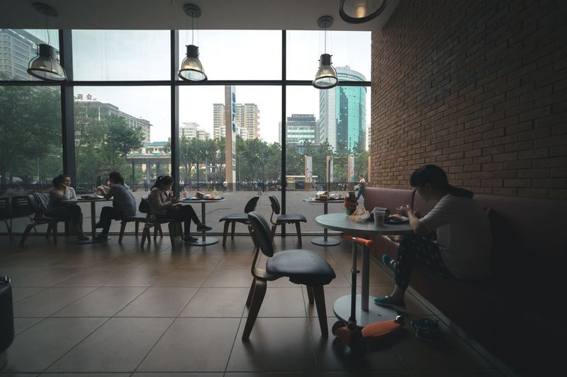 Indoors  Chair Table Window Restaurant Real People Day Architecture Built Structure Cafe Sitting Lifestyles Women Building Exterior Full Length