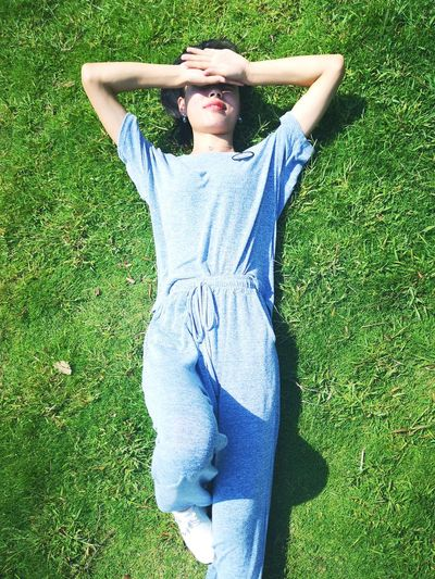 Grass Leisure Activity One Person Casual Clothing Plant Green Color Lying Down