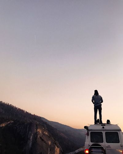 Statue on mountain against clear sky