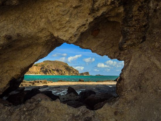Through the looking glass Landscape_Collection Wanderlust Beach Photography Through The Hole Beaches Of The World EyeEm Selects EyeEm Best Shots Beach Photography Lombok-Indonesia Tanjung Aan Indonesia_photography No People Nature Water Rock Day Rock - Object Architecture Solid Land Scenics - Nature Tranquil Scene Beauty In Nature Sunlight Outdoors Rock Formation Tranquility Sky
