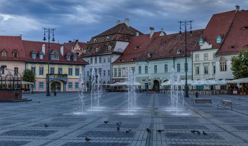 Piazza of old town Sibiu Romania Sibiu, Romania Sunrise Plazza Architecture Building Exterior Built Structure Building City Cloud - Sky Sky Water Town Travel Destinations Fountain The Past Outdoors History Residential District Street No People