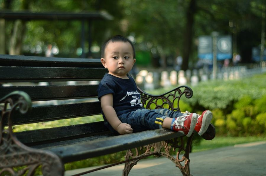 Baby sitting in the park. Sitting Childhood One Person Full Length One Boy Only Child Outdoors Children Only Close-upPeople Protruding Portrait Day Smiling Babyboy 14months Park