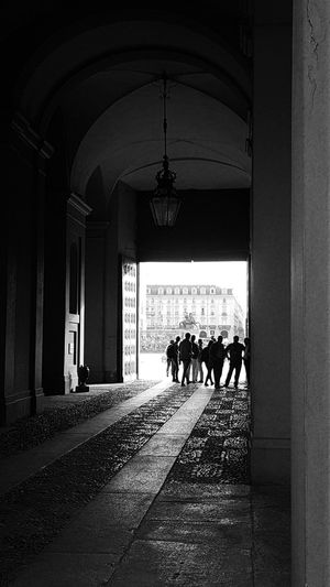Royal Palace People In The Background Real People Black And White Street Photography Street Lamp Old Street Lamp Perspective Turin Italy Men Silhouette Walking Architecture Historic Archway Entryway Colonnade Passage Arcade Passageway Entry Arch Entrance Historic Building Open Door Large Group Of People