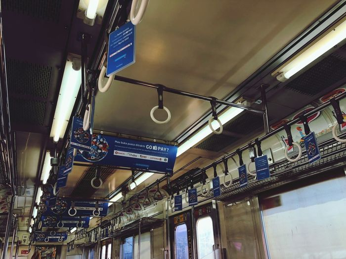 Naik kereta api tut tut tut...... EyeEm Selects Lighting Equipment Ceiling Indoors  Low Angle View Hanging Architecture No People Rail Transportation Metal Day Public Transportation In A Row Travel
