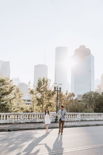 Engagement shoot with Houston's downtown in the background. Architecture Togetherness Skyscraper City Life Downtown District Cityscape Urban Skyline Engagement Married Couple Honeymoon Houston Texas Landscape Happiness