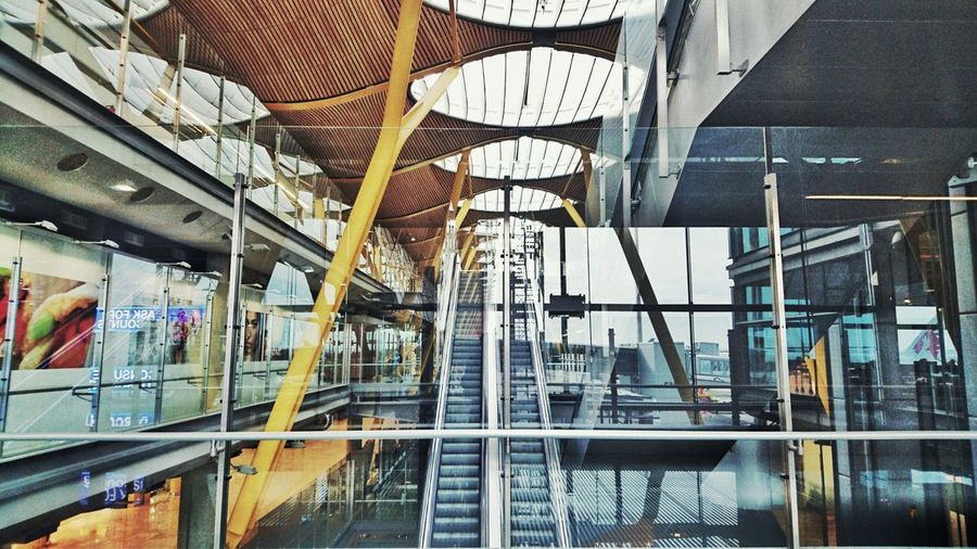 Airport Modern Indoors  Glass - Material Architecture City Airport Architecture Modern Indoors  Glass - Material Architecture City Reflection Railing Travel Destinations Architectural Feature City Life Day Abundance Retail  Person Large Group Of Objects Roof Beam Tourism