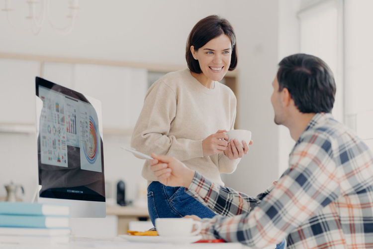 Couple discussing while working at home