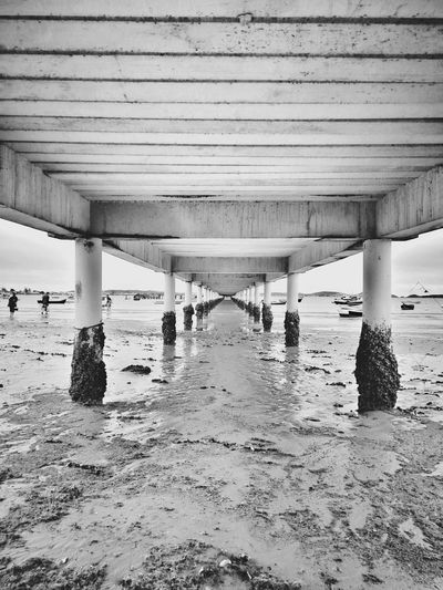 Remember but now in black and white Huaweiphotography Huawei Blackandwhite Snapseed Brasil Beauty In Nature Mobilephotography Water Underneath Sea Beach Under Bridge - Man Made Structure Sky Architecture Architectural Column Sandy Beach Passageway Shore Calm Ocean
