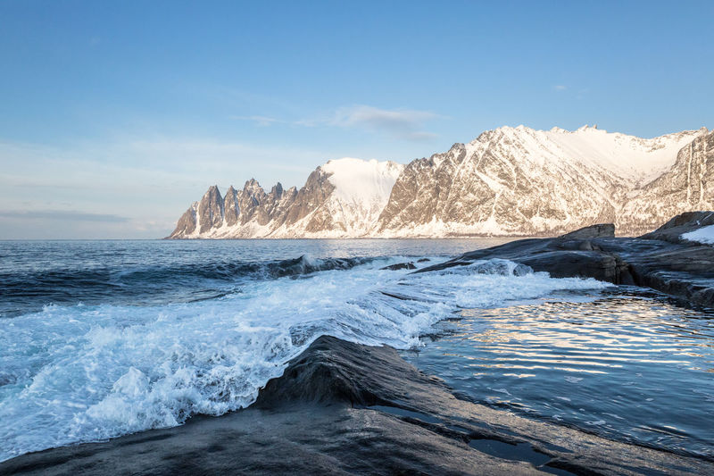 View from Tungeneset on Senja  . Beach Beauty In Nature Blue Blue Sky Evening Light Mountain Mountain Range Northern Norway Ocean Power In Nature Rock Formation Scenics Sea Seascape Snow Snowcapped Mountains Splashing Water Waterfront Wave Winter Photography In Motion