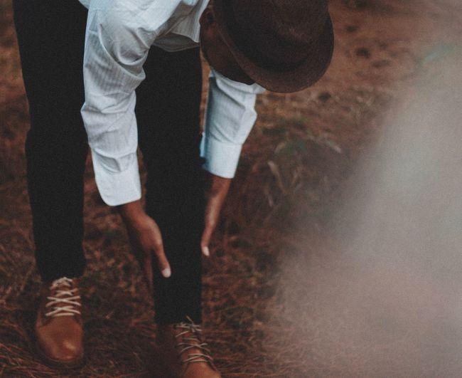 Man bending on field