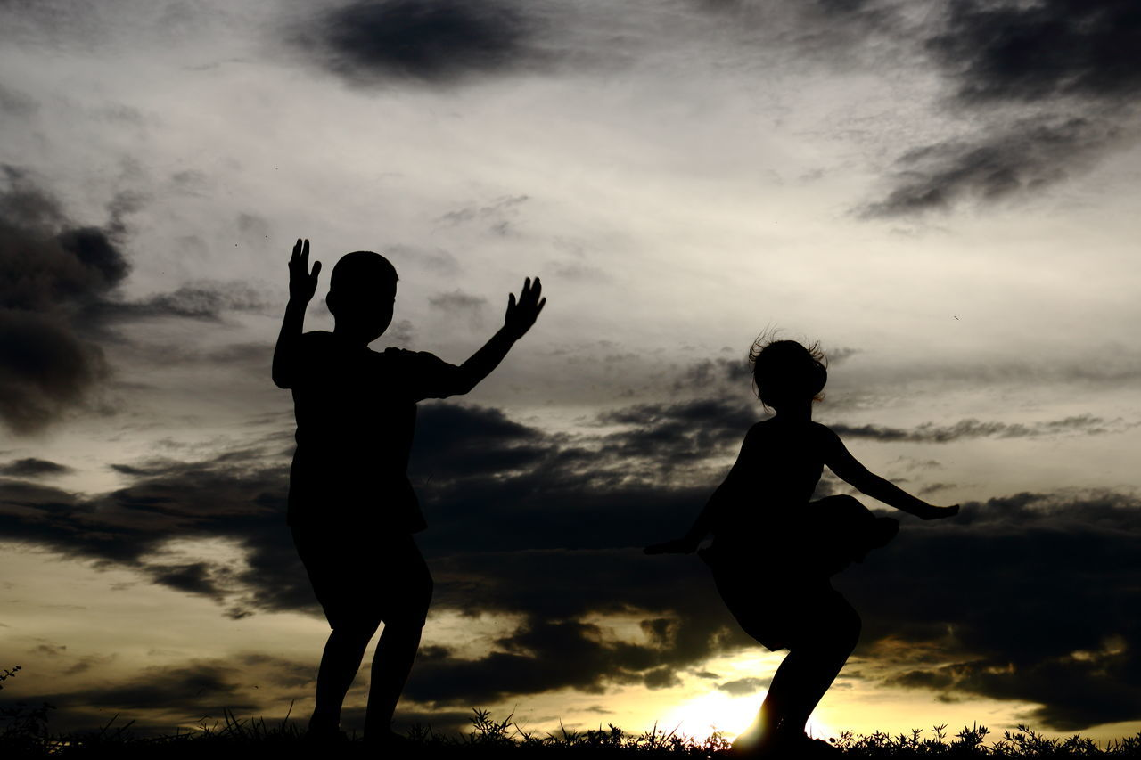 cloud - sky, sky, two people, silhouette, arms raised, real people, togetherness, sunset, leisure activity, standing, lifestyles, nature, women, full length, outdoors, scenics, beauty in nature, day