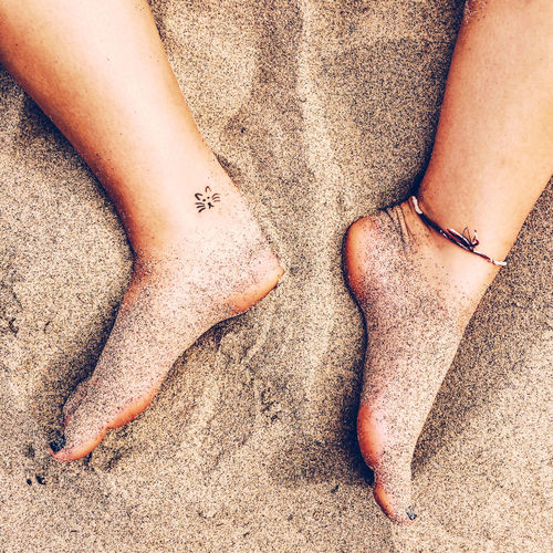 Adult Adults Only Barefoot Beach Close-up Day High Angle View Human Body Part Human Leg Leisure Activity Lifestyles Low Section Outdoors People Real People Sand Two People