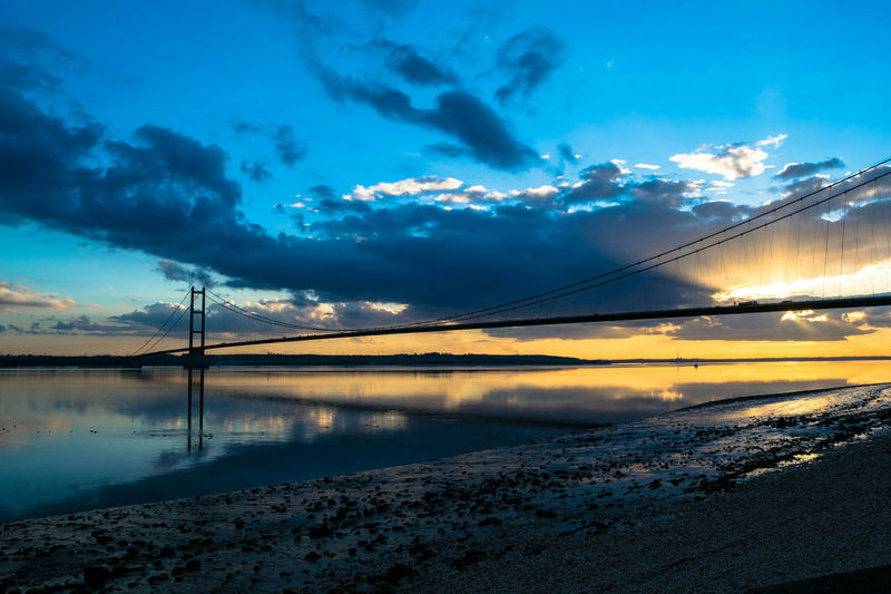 Bridge Sky And Clouds Colourful Sunset Water Reflections Beauty In Nature Bright Colors River Humber Bridge River Hull City Of Culture 2017