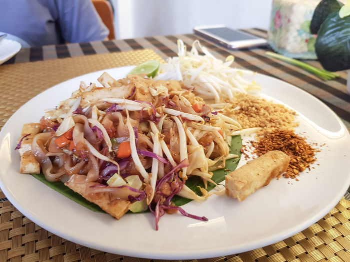 Vegetarian food concept - pad thai noodles served with cayenne pepper
