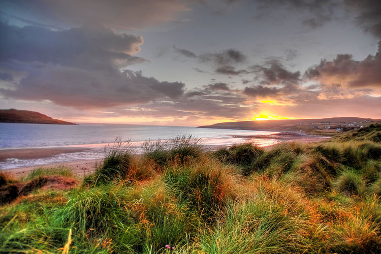 a scottish sunset Beach Beauty In Nature Cloud - Sky Coastline Day Dramatic Sky Gairloch Horizon Over Water Nature No People Outdoors Postcard Sand Scenics Scotland Sea Sky Sunset Sunset_collection Tourism Tranquil Scene Tranquility Travel Destinations Vacations Water