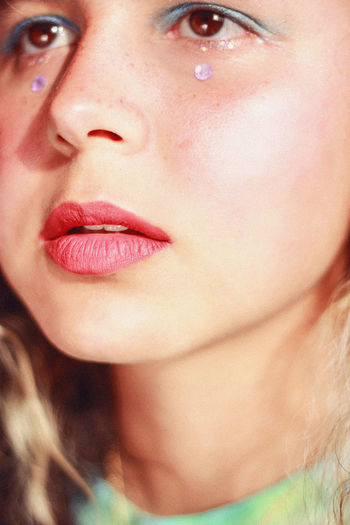 Close-up if beautiful woman with tear drops on face