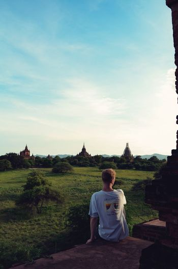Bagan, Myanmar Bagan EyeEm Nature Lover Sky Sitting One Person Plant Casual Clothing Real People Leisure Activity Spirituality Young Adult Outdoors Relaxation Day Building Exterior Tree Religion Built Structure Nature Architecture Men Lifestyles Capture Tomorrow 2018 In One Photograph 17.62° 17.62° My Best Photo