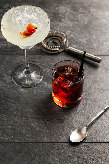 High angle view of drinks on slate