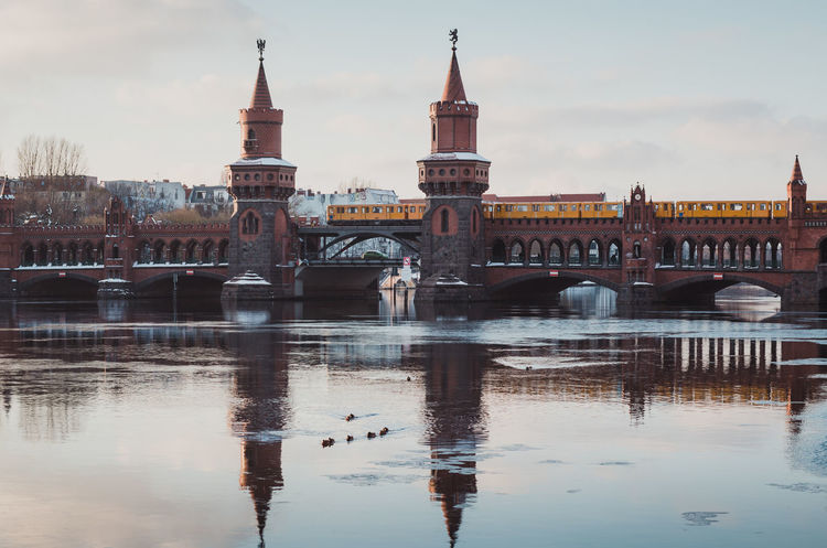 Oberbaumbridge in Berlin during the winter season Architecture Berlin Bridge City Clock Tower Connection Day Friedrichshain Ice On The Water Kreuzberg No People Oberbaumbridge Oberbaumbrücke Outdoors Reflection River Sky Spree River Berlin Travel Travel Destinations Water Waterfront Winter Winterscapes Wintertime