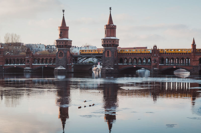 Reflection Of Oberbaum Bridge In River Against Sky