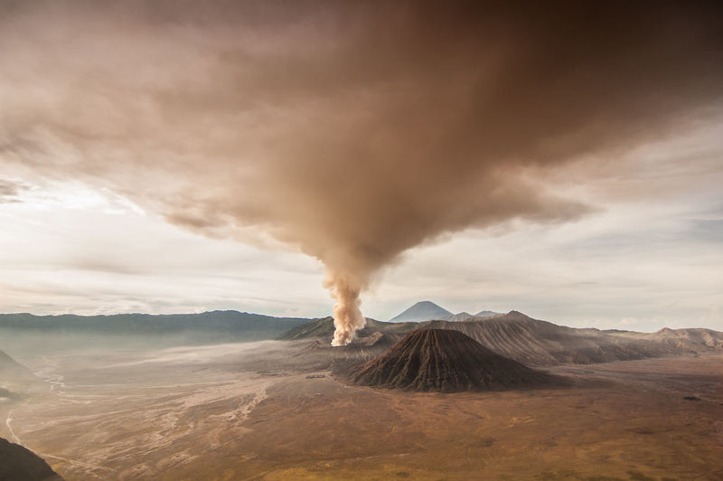 The volcanic ash of mount Bromo Covering the Sky during the last eruption in 2010. The color of the sky and land changed dramatically into dark brown during the event. INDONESIA Lost In The Landscape Nikon SemeruMountain Awesome_nature_shots Bromo Bromo Mountain Bromo Mountain Indonesia Bromo Tengger Semeru National Park Cloud - Sky Erupting Eruption Eruption🗻 Eyem Best Shots Geology Indonesia_allshots Indonesia_photography Landscape Nikonphotography Power In Nature Semeru Volcanic  Volcanic Crater Volcanic Landscape Fresh On Market 2017