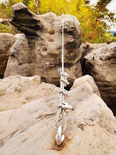 Low angle view of ropes on rock